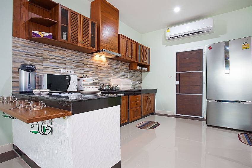 Kitchen Melodious Villa in East Pattaya
