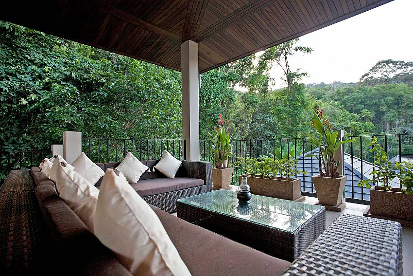 Take in the tropical surroundings from the outdoor lounge at Pagarang Villa Phuket