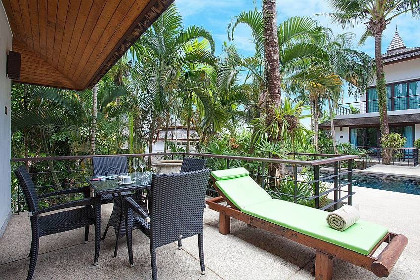 Outdoor dining area with sun lounger of Nirano Villa 25 Phuket
