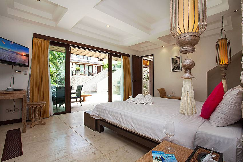 Master bedroom with TV at Nirano Villa 25 in Kathu Phuket