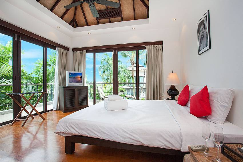 Guest bedroom with balcony at Nirano Villa 25 Phuket