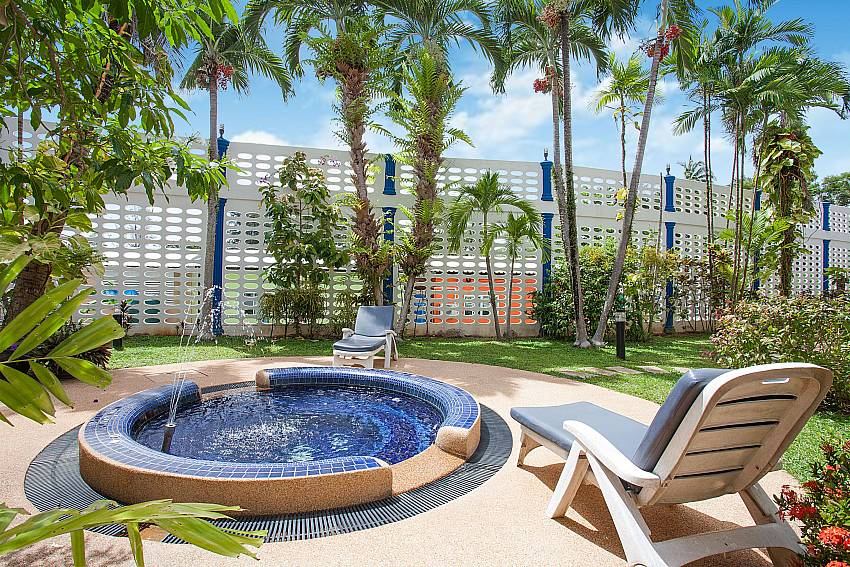 Communal Jacuzzi area with sun beds at Apartment Khuno 103 Phuket