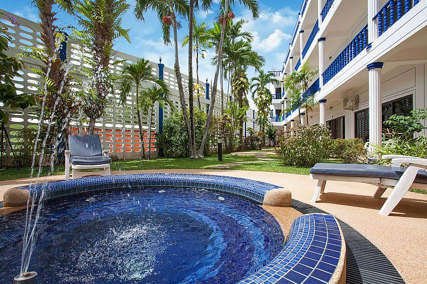 Lush green scenery by the Jacuzzi pool of Apartment Khuno 103 in West-Phuket