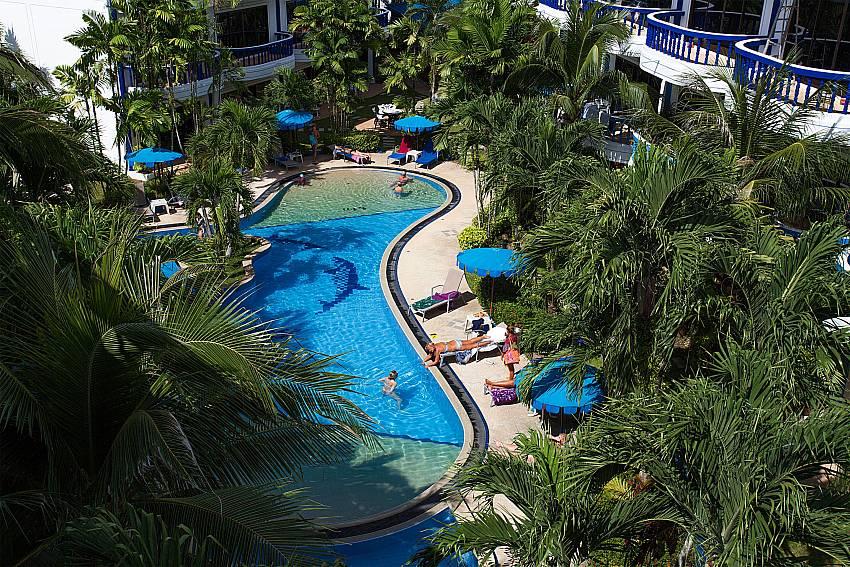 Big communal pool with lots of greenery at Apartment Khuno 103 Phuket