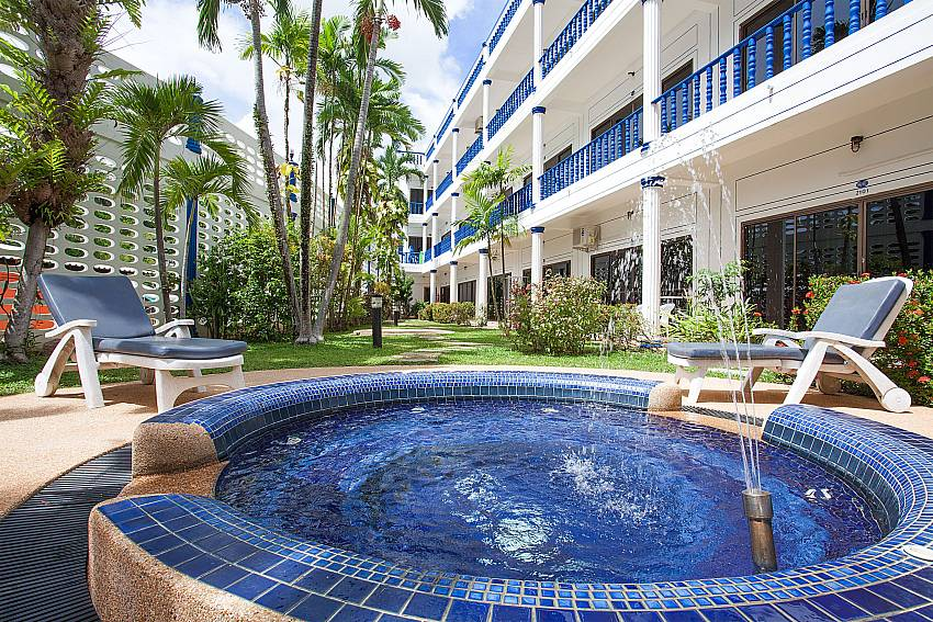 Sun chairs by the communal Jacuzzi pool at Apartment Khuno 203 in West-Phuket