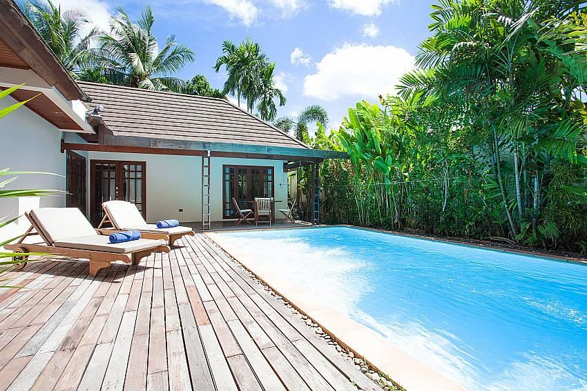 Pool deck with sunchairs at Villa Armorela 201 in Bangtao Phuket
