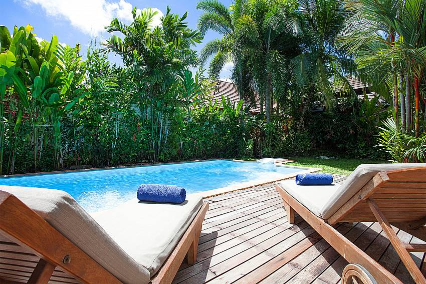 Sun loungers on the pool deck at Villa Armorela 201 in Phuket