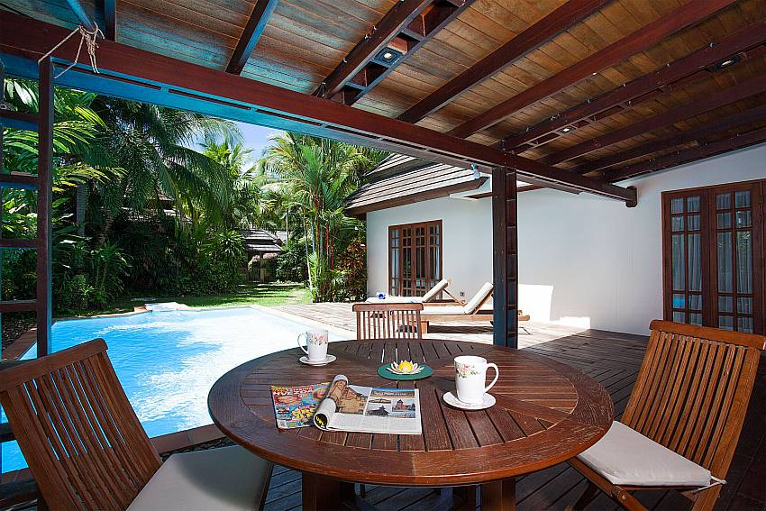 Open air dining at the pool side at Villa Armorela 201 in Phuket