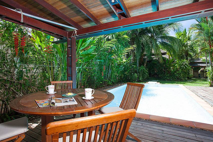 Open air dining by the pool of Villa Armorela 201 in Phuket