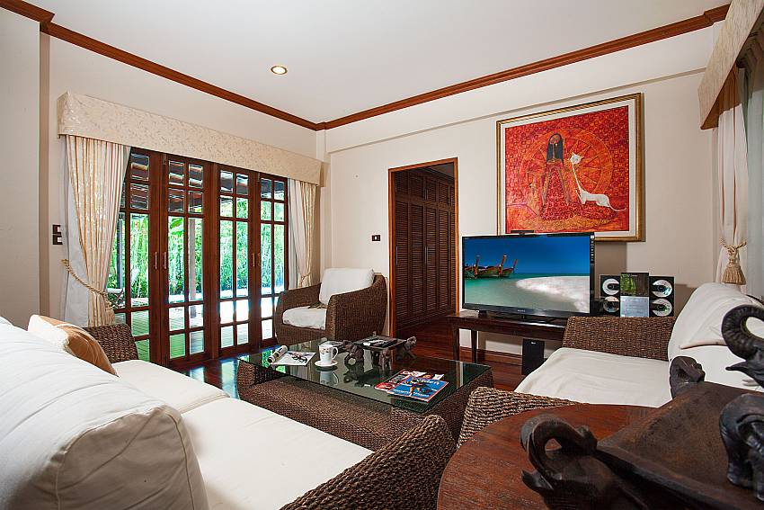 Living room with TV at the Villa Armorela 201 in Phuket