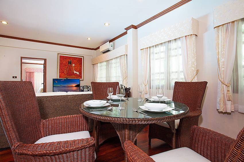 Dining table in open living area of Villa Armorela 201 at Westphuket