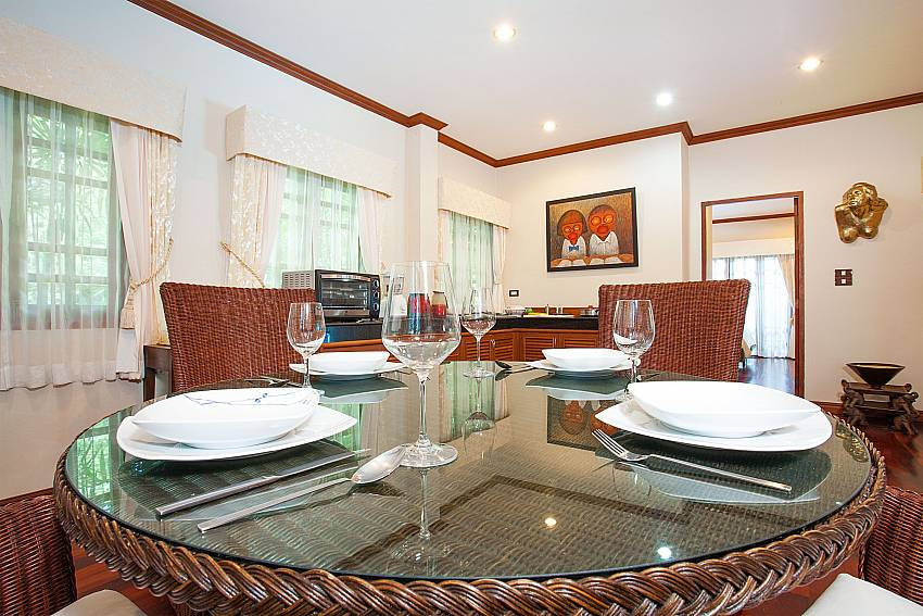 Dining table in the open living area of Villa Armorela 201 Phuket