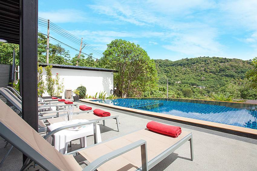 Sun chairs by the private pool of Big Buddha Hill Villa 2 in Phuket