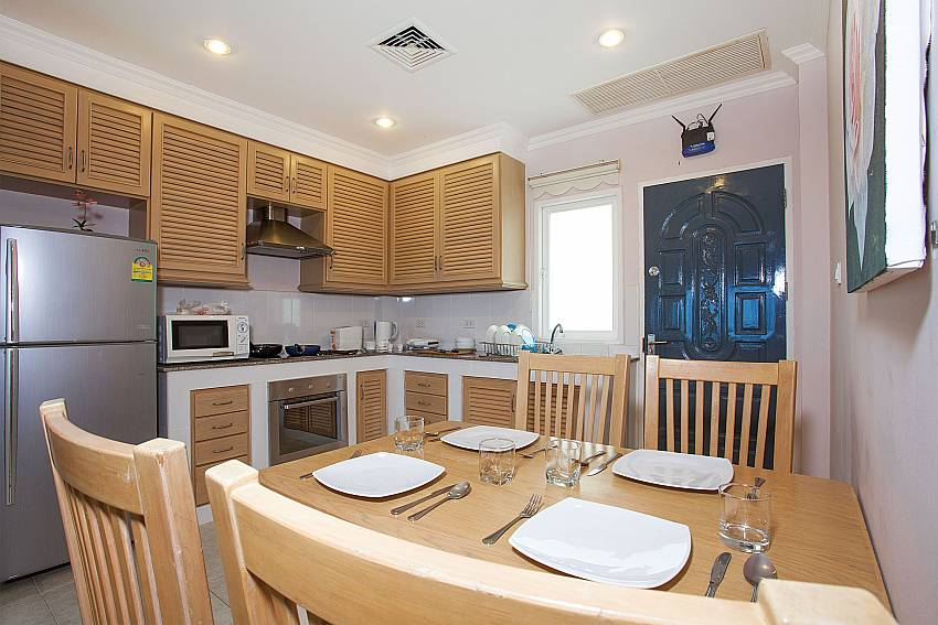 4 seat dining table with kitchen at Manuae Condo 202 in Westphuket