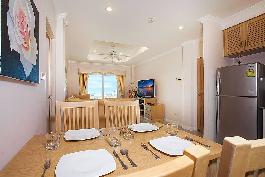 Open dining and living area at Manuae Condo 202 in Phuket