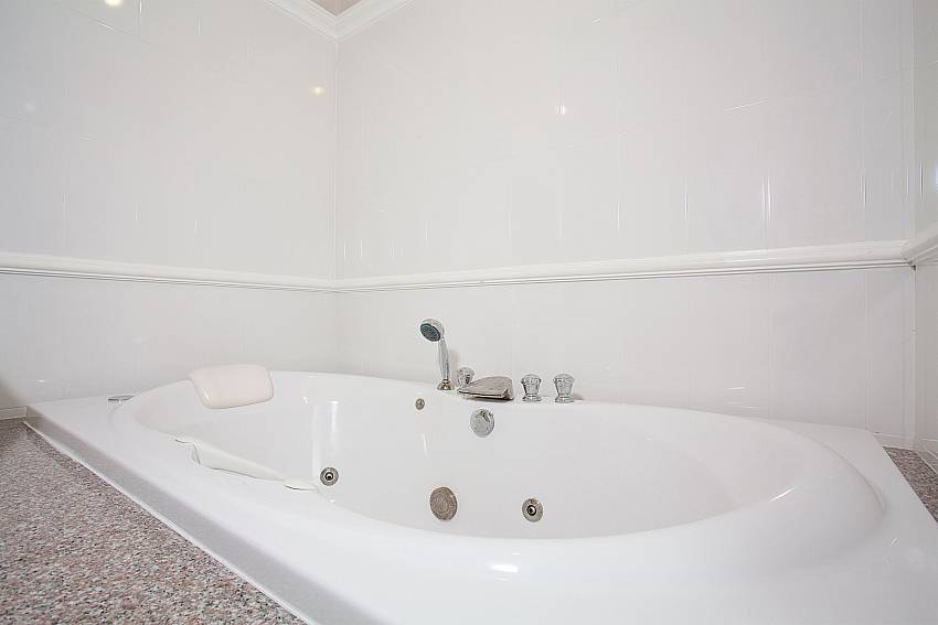 Jacuzzi bathtub in master bathroom of Manuae Condo 202 in Phuket
