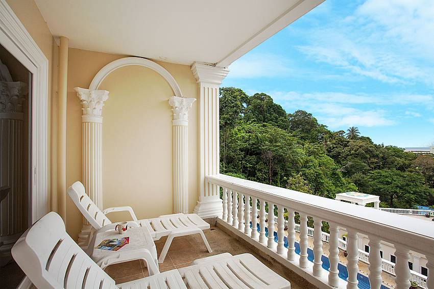 Private balcony with sun loungers at Manuae Condo 202 Phuket