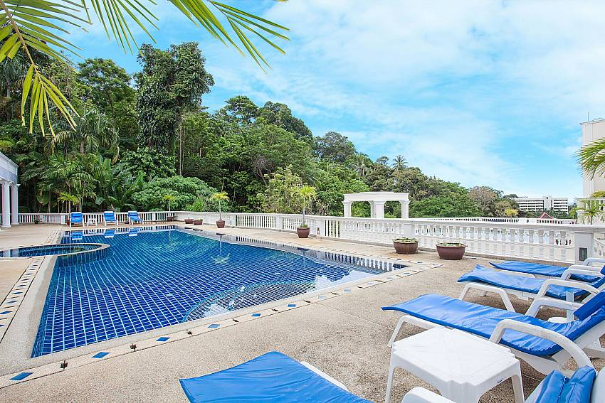 Communal pool with sun loungers at Manuae Condo 202 Phuket