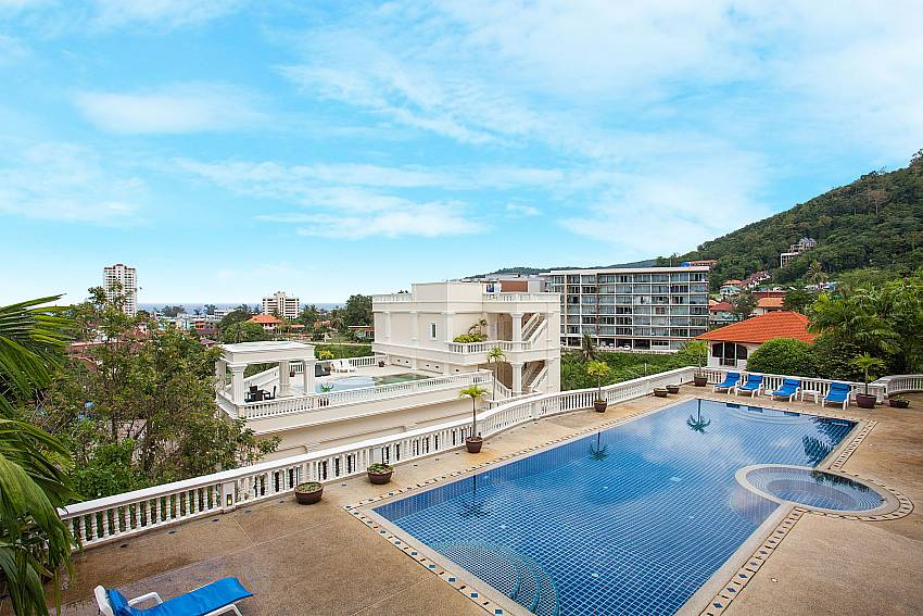 Communal pool area and sea view at Manuae Condo 202 West Phuket