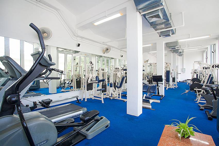 Modern gym at Manuae Condo 102 on sunset coast Phuket
