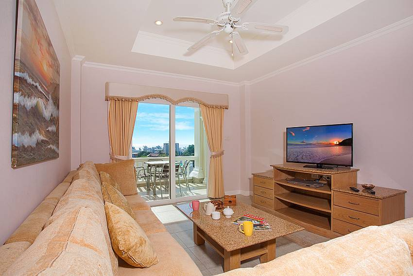 Open living with access to private balcony Manuae Condo 102 Phuket