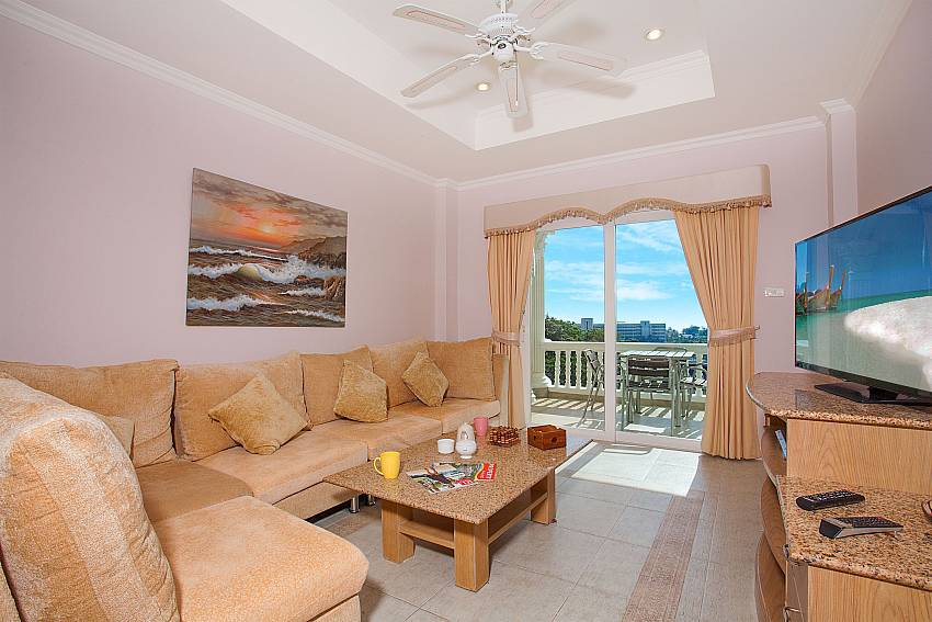 Comfortable sitting with TV in the lounge of Manuae Condo 102 Phuket