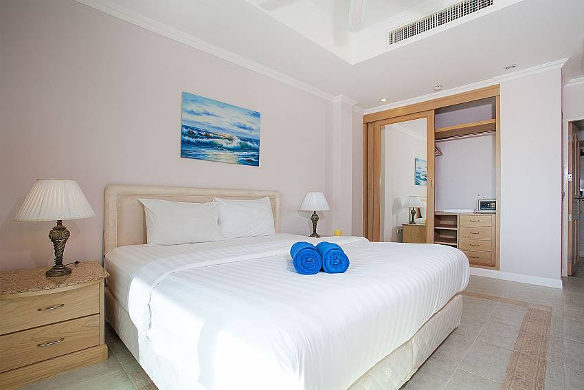 King-size bed and safe in bedroom of Manuae Condo 102 Phuket