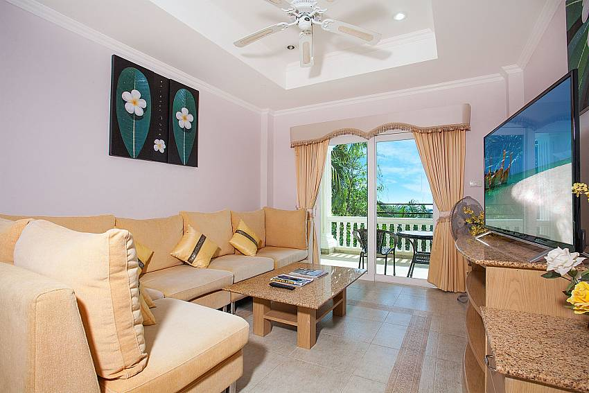 Lounge with view and TV at 2 bed Manuae Condo 201 in Phuket
