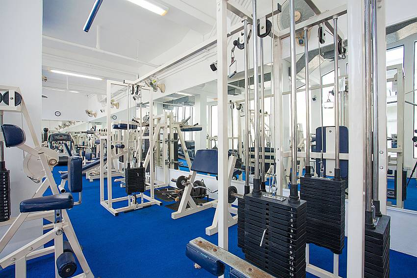 Modern gym at the apartment house of Manuae Condo 201 in Phuket