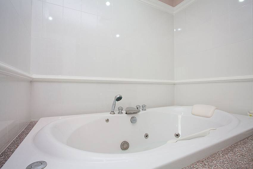 Jacuzzi bathtub in en-suite master bath of Manuae Condo 201 in Westphuket