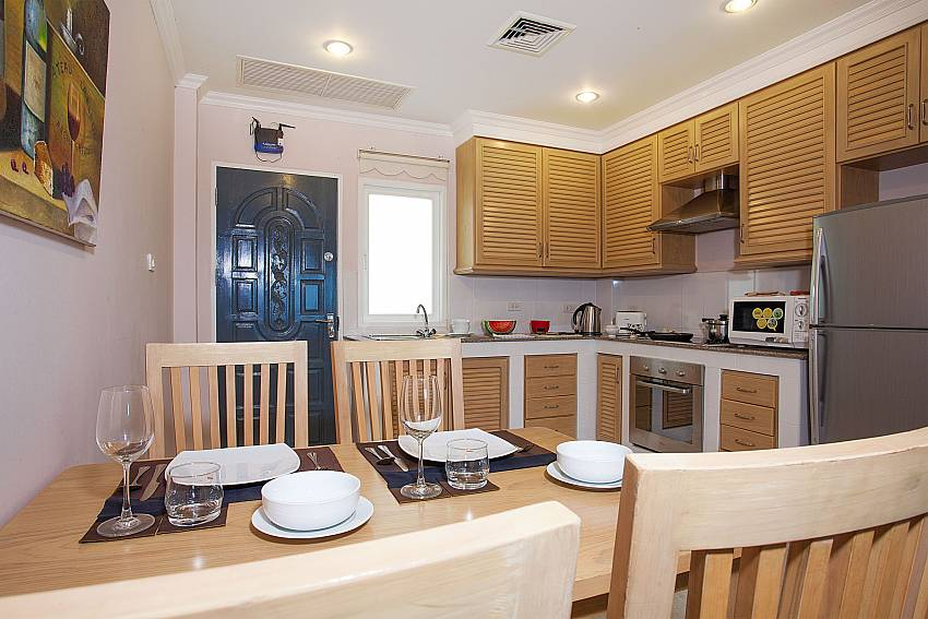 4 seat dining table and kitchen in Manuae Condo 101 West-Phuket