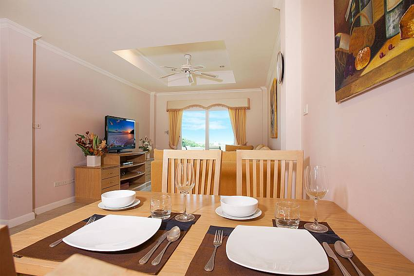Open dining and living area at Manuae Condo 101 in Phuket