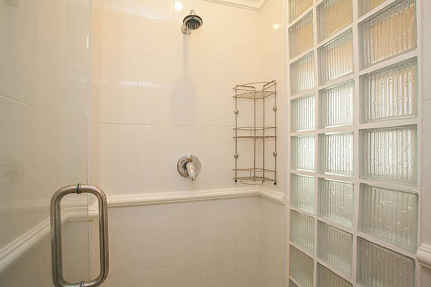 Shower in bathroom of Manuae Condo 101 Phuket