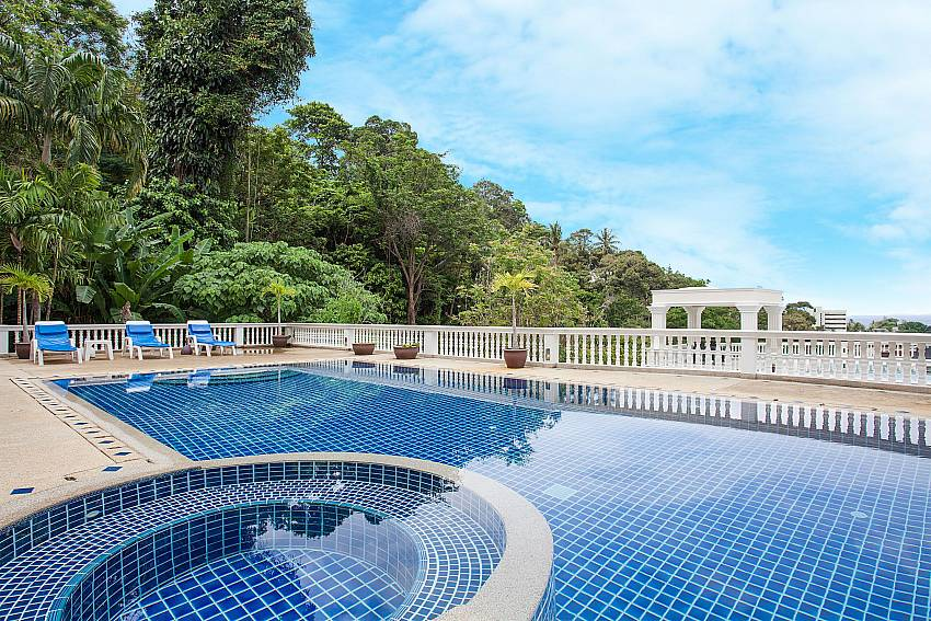 Communal pool area with view at Manuae Condo 101 Phuket
