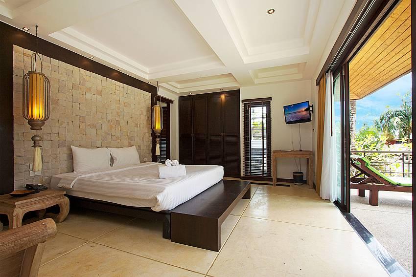 Master bedroom with TV at Nirano Villa 26 in Kathu Phuket