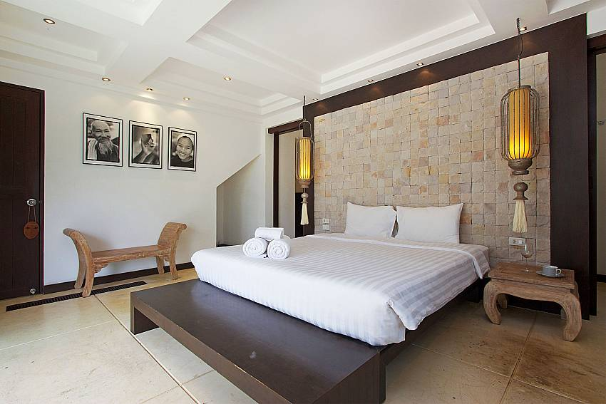 King-size bed in master bedroom at Nirano Villa 26 Phuket