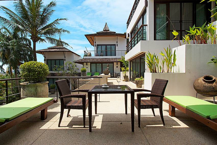 Big terrase with table and sun chairs at Nirano Villa 26 Phuket