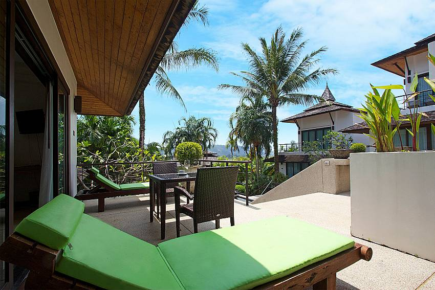 Sun loungers and dining table at Nirano Villa 26 in Central Phuket