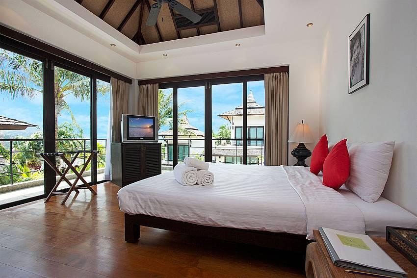 Guest bedroom with TV at Nirano Villa 26 Phuket