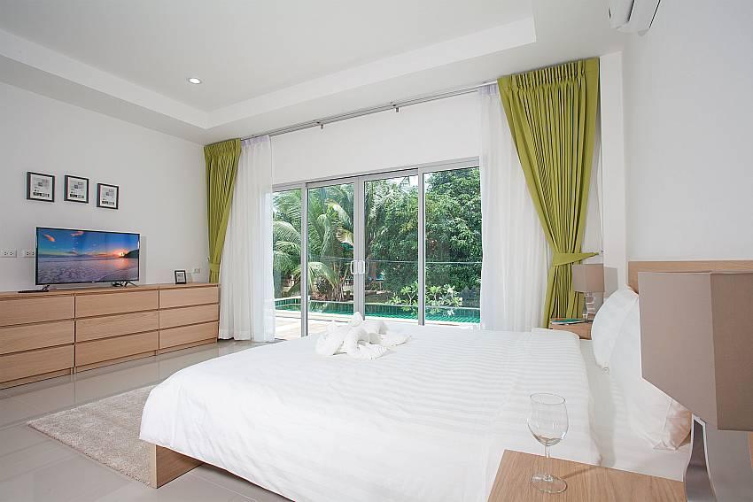 1. bedroom with TV and direct pool access Villa Inigo No.2 Koh Samui