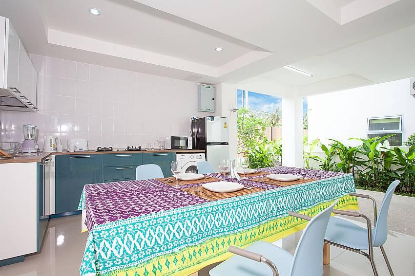 4 seat dining table in open kitchen at Villa Inigo No.2 in Koh Samui