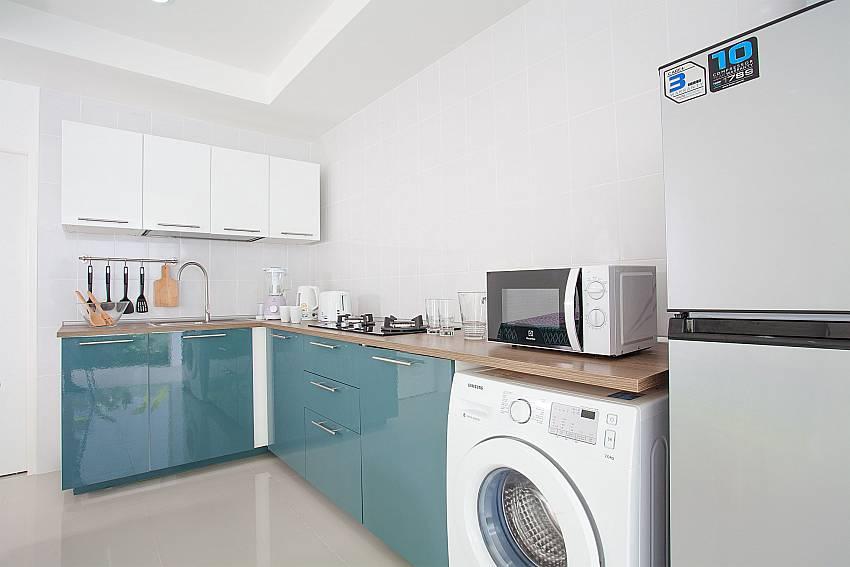 Westen style kitchen with washing mashine at the ground floor of Villa Inigo No.2 Koh Samui