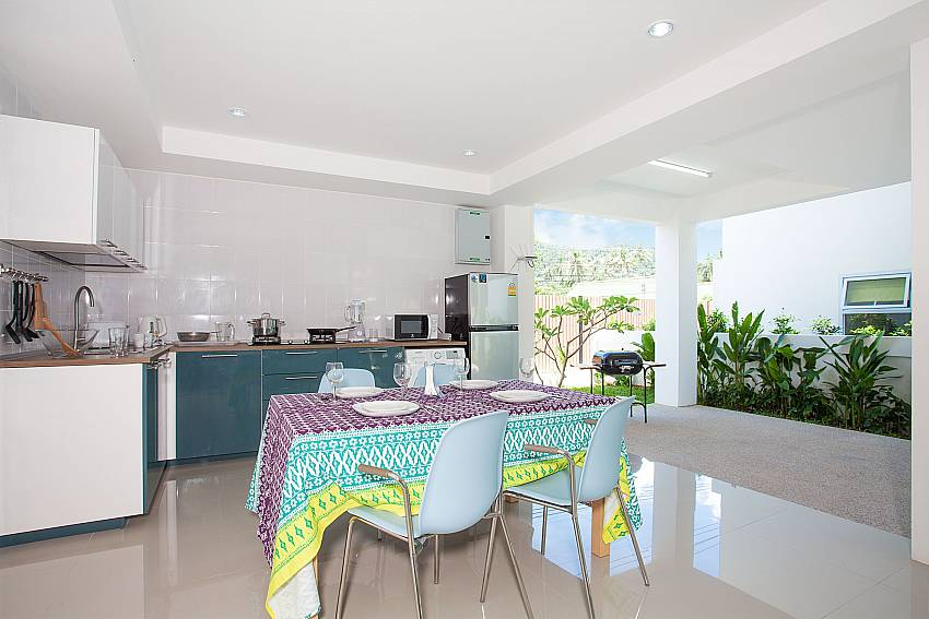 Ground floor open air kitchen with 4 seat dining table Villa Inigo No.3 Samui