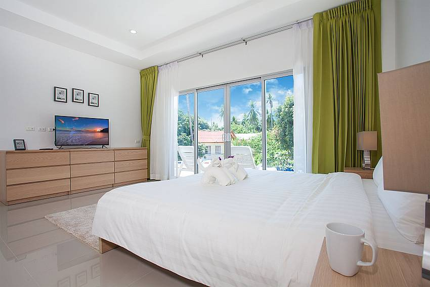 1. bedroom with TV and view at Villa Inigo No.3 in Koh Samui