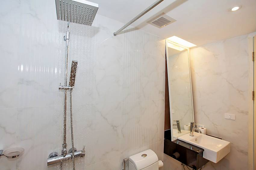 2 shower heads in the bathroom of Sadhay A2 Condo Phuket
