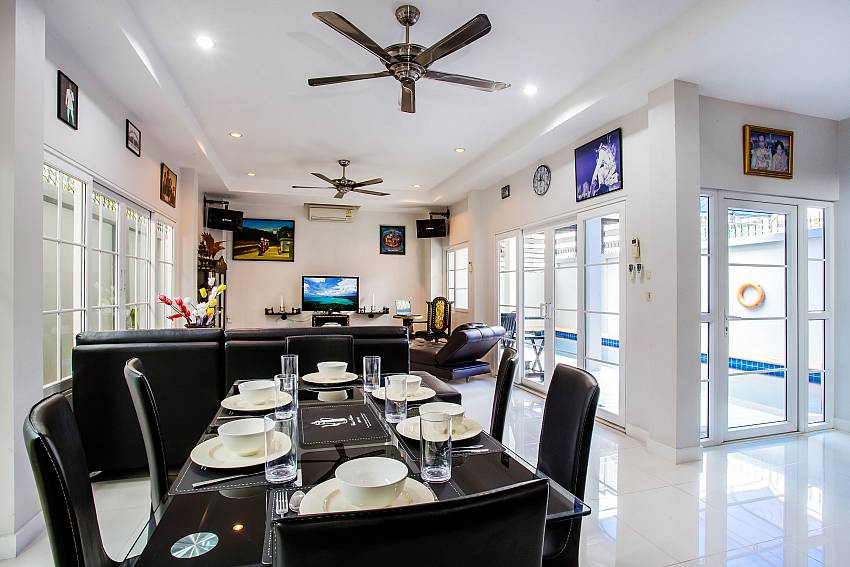 Jomtien Sunrise Villa Pattaya dining and living with pool view