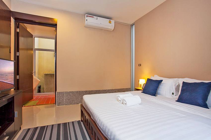 guest double bedroom with ensuite bathroom Rustic Gold Villa Pattaya
