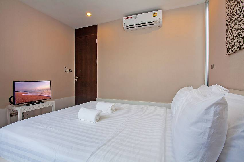3. bedroom with king size bed and tv at Rustic Gold Villa Pattaya