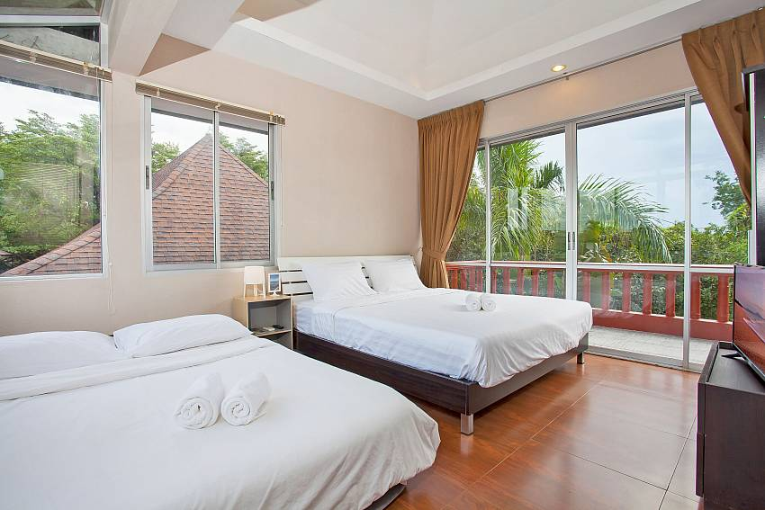 4. bedroom with 2 double beds and balcony at Rustic Gold Villa Pattaya