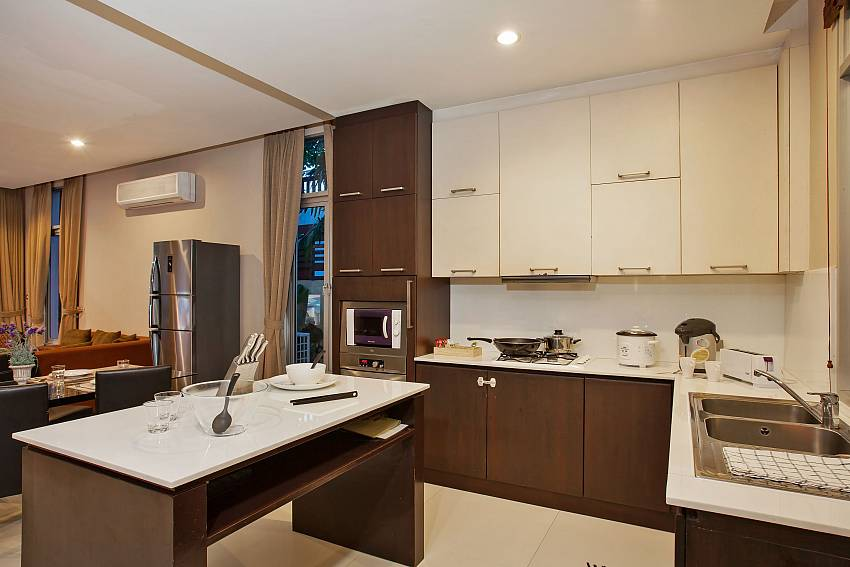 Open plan kitchen, dining and living of Rustic Gold Villa Pattaya